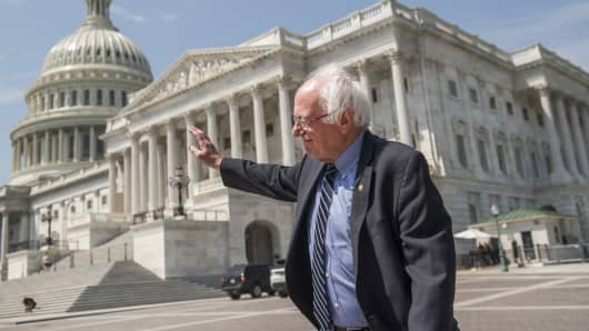 Sen. Bernie Sanders, I-Vt., waves to people shouting his name on the East Front of the Capitol on August 2, 2017.