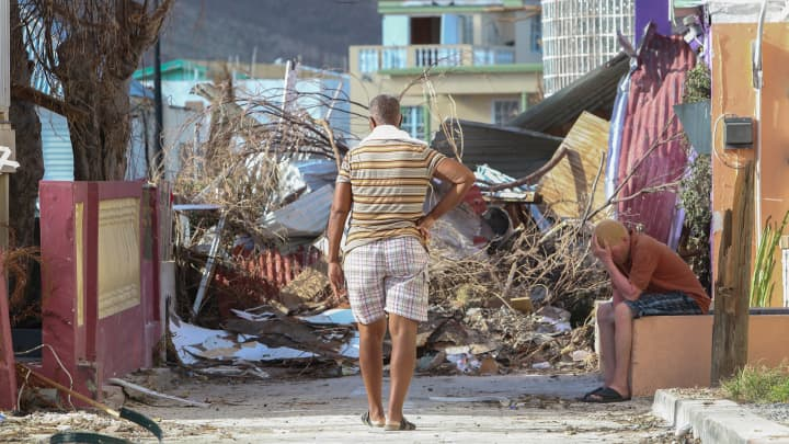 Residents observe the damage left by Hurricane Irma on September 11, 2017 in Philipsburg, St. Martin. The Caribbean island sustained extensive damage from the powerful storm.