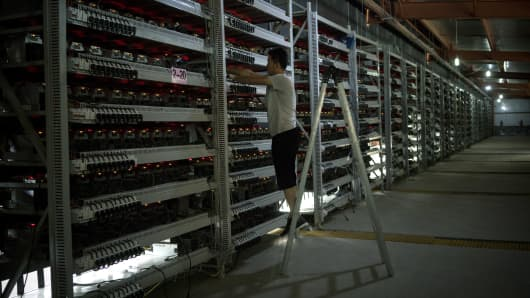 Li Shuangsheng, 28, at work in the bitcoin farm at the Bitmain China facility, which issues over $300,000 in digital currency a day, in Dalad Banner, Inner Mongolia, China, Aug. 11, 2017.