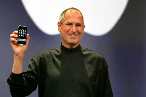 Apple chief executive Steve Jobs unveils a new mobile phone that can also be used as a digital music player and a camera, a long-anticipated device dubbed an 'iPhone.' at the Macworld Conference 09 January, 2007 in San Francisco, California.