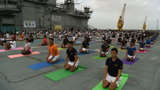 Indian Armed Forces personnel take part in a yoga session to mark International Yoga Day at the Mumbai harbor on June 21, 2017.