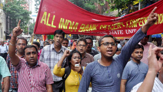 Bank employees rally at a nationwide strike on August 22, 2017 in Kolkata, India.