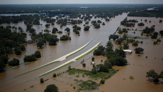 A highway stands immersed in floodwaters from Hurricane Harvey in this aerial photograph taken above West Columbia, Texas, U.S., on Wednesday, Aug. 30, 2017.