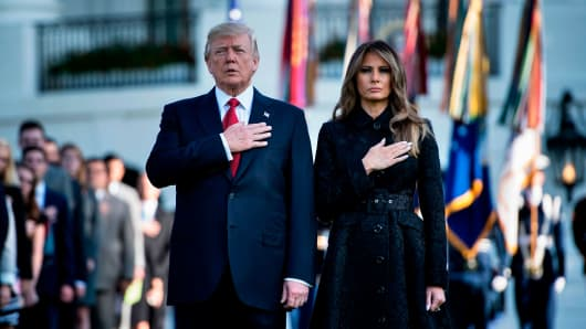 President Donald Trump and First Lady Melania Trump observe a moment of silence on September 11, 2017, at the White House in Washington, DC, during the 16th anniversary of 9/11.
