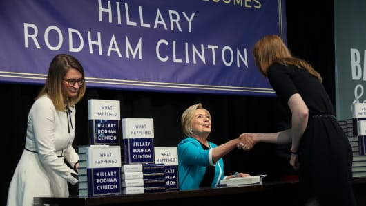 Former Secretary of State Hillary Clinton signs copies of her new book 'What Happened' during an event at a Barnes & Noble bookstore, Sept. 12, 2017, in New York City.