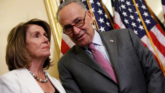 Senate Minority Leader Chuck Schumer speaks with House Minority Leader Nancy Pelosi at a news conference about the Child Care for Working Families Act at the U.S. Capitol September 14, 2017 in Washington, DC.