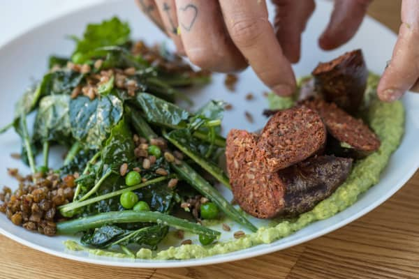 Chef Oliver Plust prepares his daily special, lamb merguez, at Tender Greens in Hollywood, California. Each location of the fine-casual chain is run by its own chef and features a unique menu.