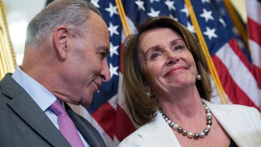 Senate Minority Leader Charles Schumer, D-N.Y., and House Minority Leader Nancy Pelosi, D-Calif., attend a news conference on September 14, 2017.