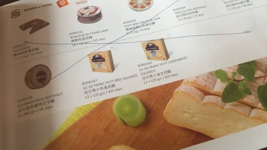 "An ""x"" is drawn through a selection of cheeses that are no longer available after bans from Chinese authorities."