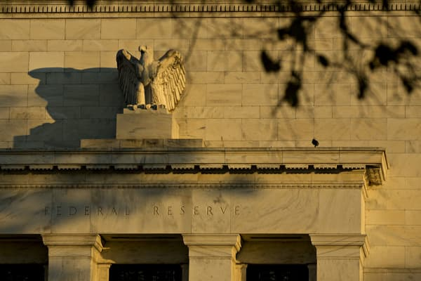 An eagle sculpture stands on the facade of the Marriner S. Eccles Federal Reserve building in Washington, D.C., U.S., on Friday, Nov. 18, 2016.