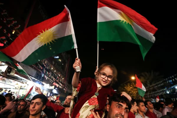 Iraqi Kurds celebrate while urging people to vote in the upcoming independence referendum in Arbil, the capital of the autonomous Kurdish region of northern Iraq, on September 8, 2017.