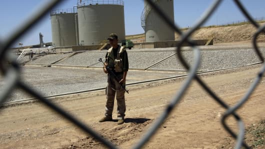 A security guard is seen at the Tawke oil refinery near the village of Zacho, in the autonomous Iraqi region of Kurdistan, on May 31, 2009.