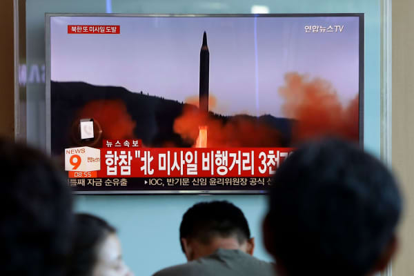 People watch a television broadcast reporting the North Korean missile launch at the Seoul Railway Station on September 15, 2017 in Seoul, South Korea.
