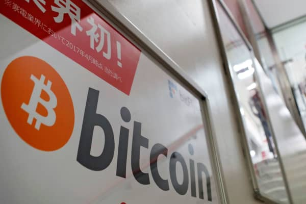 A logo of Bitcoin is seen on an advertisement of an electronic shop in Tokyo, Japan September 5, 2017.