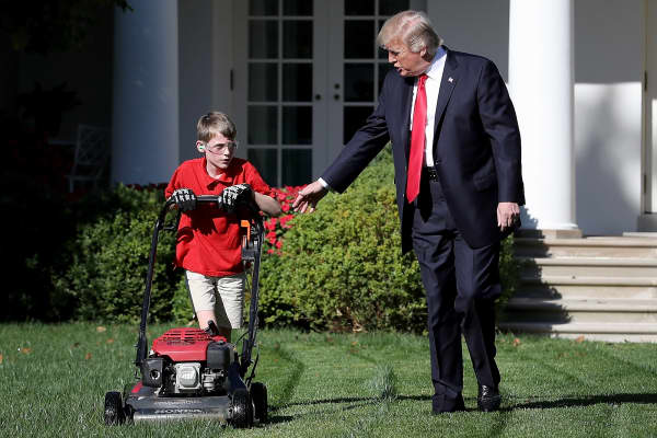 U.S. President Donald Trump talks with 11-year-old Frank 'FX' Giaccio while he mows the grass in the Rose Garden of the White House September 15, 2017 in Washington, DC.