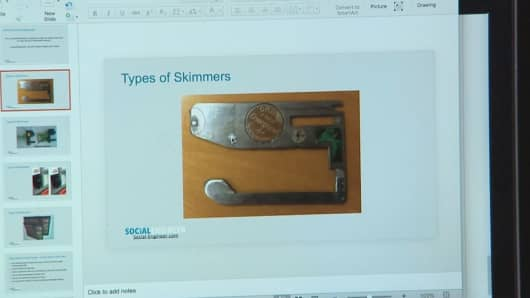 This skimmer, found for sale on the dark web, is as thin as a credit card and invisible from the outside of the machine.