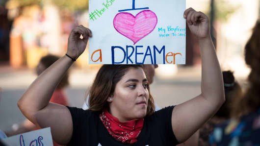 DACA supporter, Lauren Gonzales, protests the Trump administrations termination of the Deferred Action for Childhood Arrivals program.