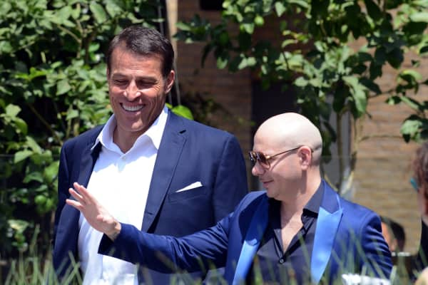 Motivational speaker Tony Robbins and rapper Pitbull attend Pitbull's Star Ceremony on The Hollywood Walk Of Fame on July 15, 2016 in Hollywood, California.