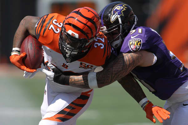 Jeremy Hill #32 of the Cincinnati Bengals is tackled by Kamalei Correa #51 of the Baltimore Ravens during the third quarter at Paul Brown Stadium on September 10, 2017 in Cincinnati, Ohio.