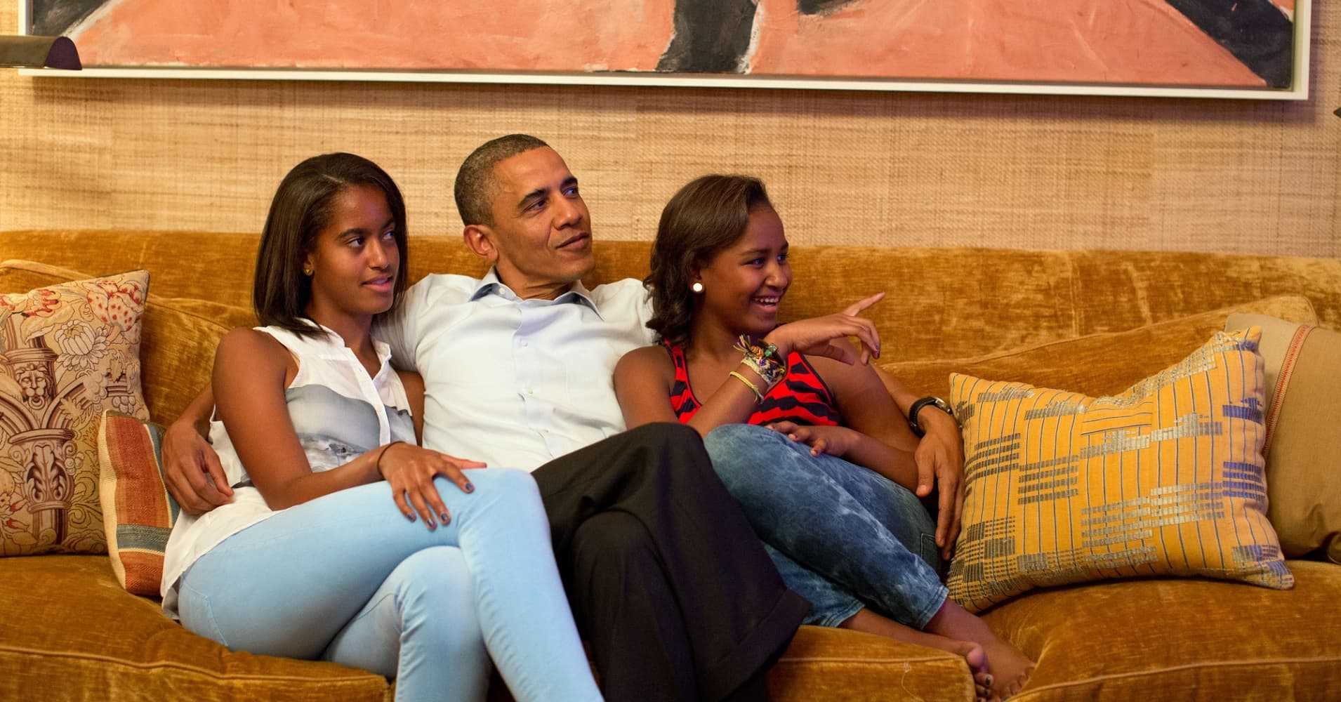 U.S. President Barack Obama and his daughters, Malia (L) and Sasha, watch on television as first lady Michelle Obama takes the stage to deliver her speech at the Democratic National Convention on September 4, 2012 in the Treaty Room of the White House in Washington, DC.