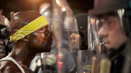 Demonstrators confront police while protesting the acquittal of former St. Louis police officer Jason Stockley on September 16, 2017 in St. Louis, Missouri.