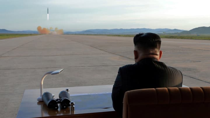 North Korean leader Kim Jong Un watches the launch of a Hwasong-12 missile in this undated photo released by North Korea's Korean Central News Agency (KCNA) on September 16, 2017.