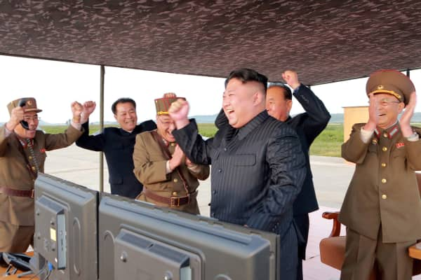 North Korean leader Kim Jong Un guides the launch of a Hwasong-12 missile in this undated photo released by North Korea's Korean Central News Agency (KCNA) on September 16, 2017.