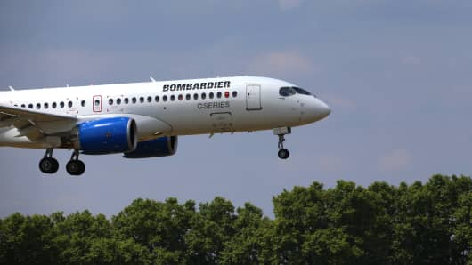 A Bombardier CS300 C Series aircraft, manufactured by Bombardier Inc., lands after a flying display on day two of the 51st International Paris Air Show in Paris, France, on Tuesday, June 16, 2015.