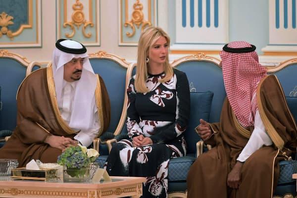 Prince Faisal bin Bandar (L), the governor of the Saudi capital Riyadh, listens on as Ivanka Trump talks to an unidentified Saudi official during a ceremony where her father US President Donald Trump received the Order of Abdulaziz al-Saud medal from Saudi Arabia's King Salman bin Abdulaziz al-Saud at the Royal Court in Riyadh on May 20, 2017.