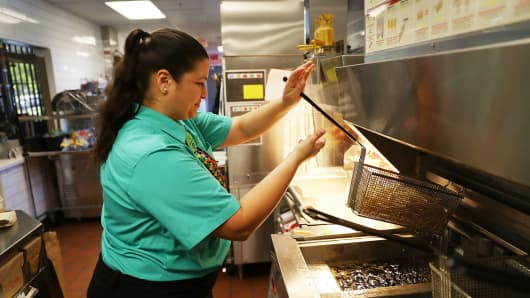 McDonald's crew member Samantha Medina prepares french fries in Miami, Florida.