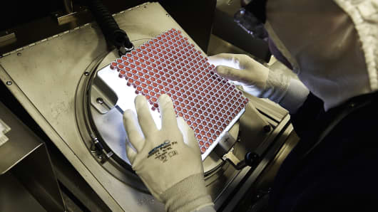 An employee works on the production of insulin pens at the factory of the US pharmaceutical company Eli Lilly in Fegersheim, France.