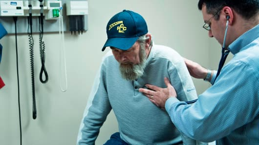 Don Humbertson, a 64 year old lung cancer surviver, is examined by Dr. Wade Harvey at the Clay-Battelle Community Health Center March 21, 2017 in Blacksville, West Virginia.