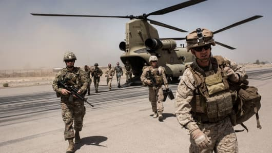 U.S. service members walk off a helicopter on the runway at Camp Bost on September 11, 2017 in Helmand Province, Afghanistan.