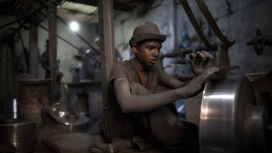 A child working in an aluminium pot-making factory on May 23, 2017 in Dhaka, Bangladesh.