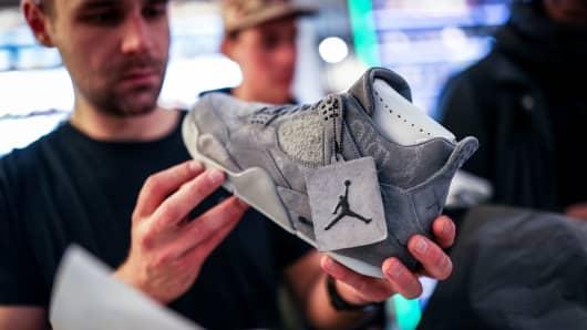 A customer shops for a Nike shoe.