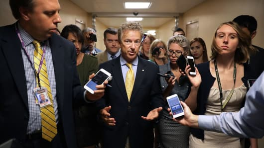 Sen. Rand Paul (R-KY) (C) returns to his office after bringing the Senate into session at the U.S. Capitol July 31, 2017 in Washington, DC.