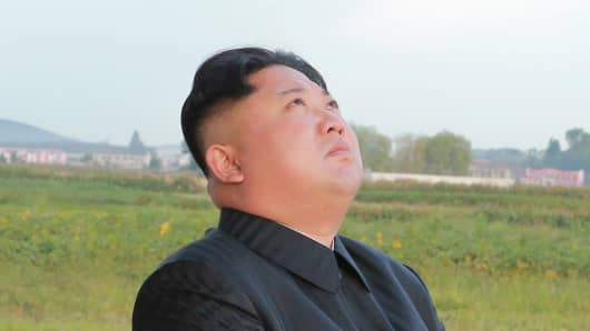 North Korean leader Kim Jong Un watches the launch of his country's own Hwasong-12 missile in this undated photo released by North Korea's Korean Central News Agency (KCNA) on September 16, 2017.