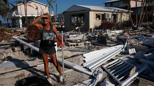 A woman surveys the damage to her mother's house following Hurricane Irma in Big Pine Key, Florida, U.S., September 18, 2017.