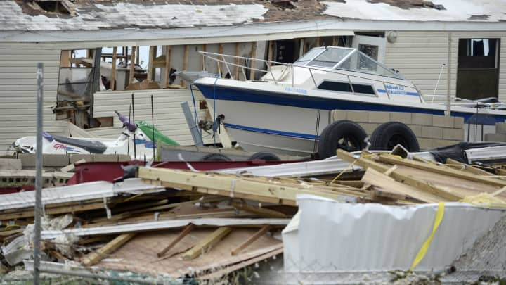 A pleasure boat stands next to a destroyed home after the passing of Hurricane Irma, in Culebra, Puerto Rico, Thursday, Sept. 7, 2017.