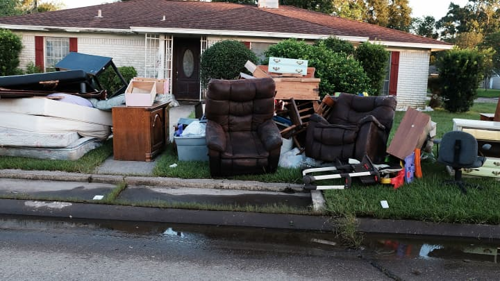 Discarded furniture and other household items sit on the curb outside of a flooded home in Orange as Texas slowly moves toward recovery from the devastation of Hurricane Harvey on September 7, 2017 in Orange, Texas.
