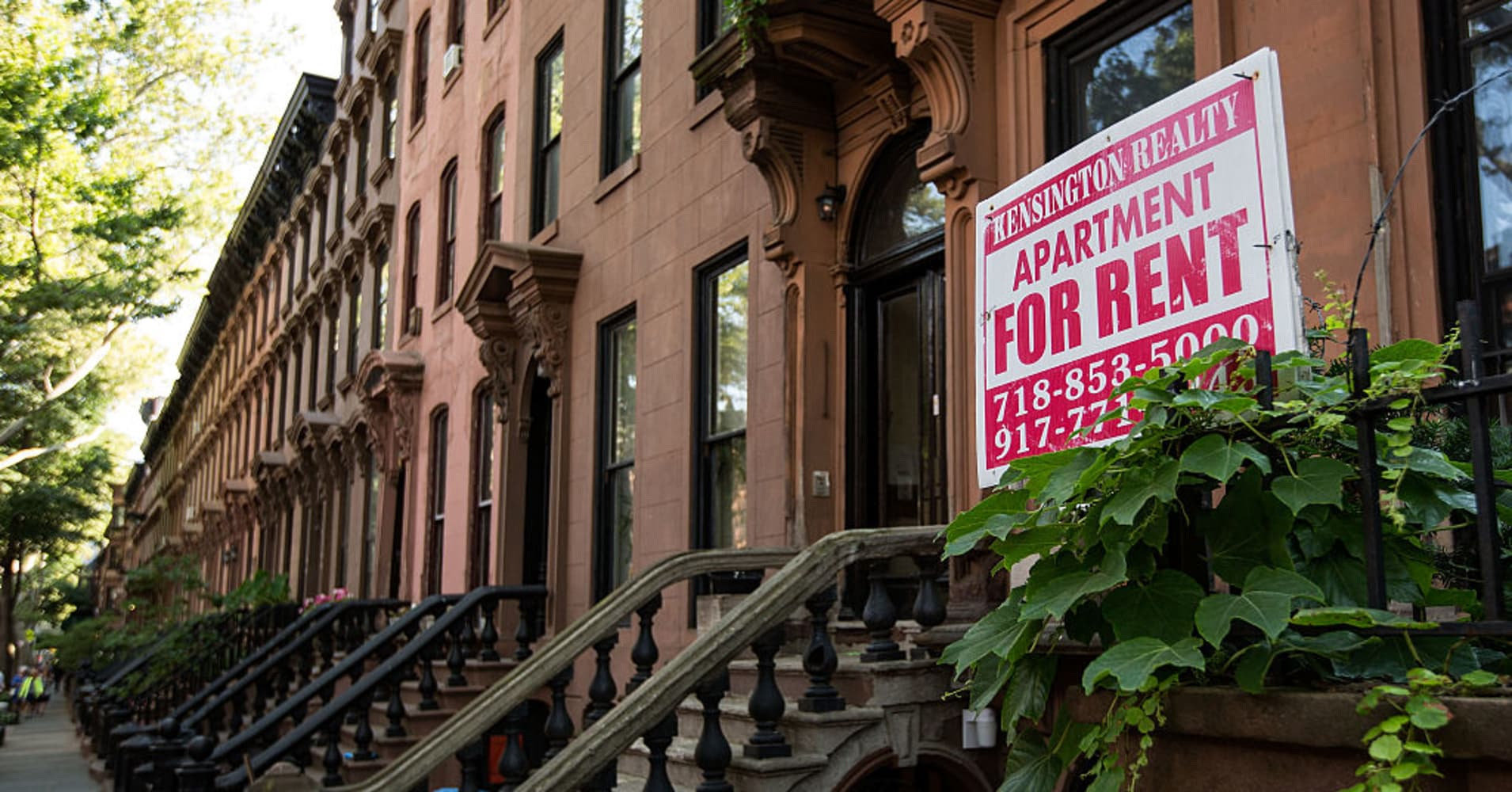 A sign advertises an apartment for rent along a row of brownstone townhouses on June 24, 2016 in the Brooklyn borough of New York City.