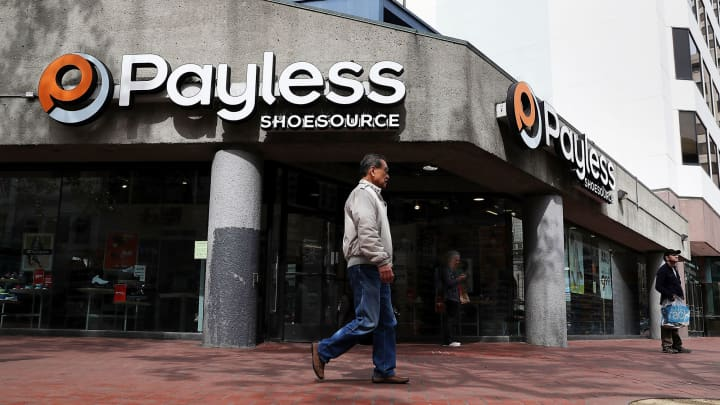 A pedestrian walks by a Payless Shoe Source store on April 5, 2017 in San Francisco.