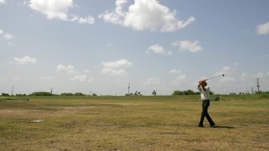 File photo of a golfer hitting a shot on the 10th hole of the Fort Brown Memorial Golf Course in front of the proposed site of the border fence on Wednesday, June 25, 2008 in Brownsville, Texas.