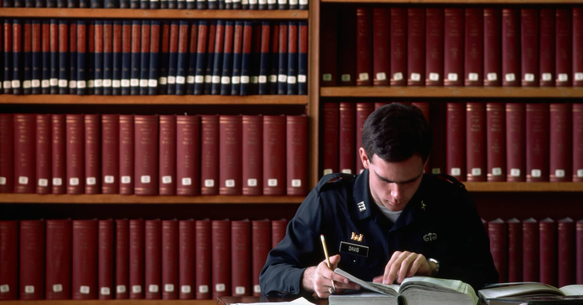 A military academy student studies in a library at West Point.