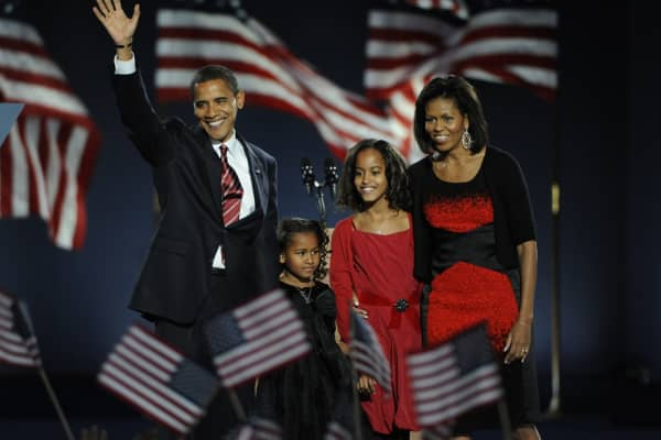 As the 44th President of the United States of America Barack Obama takes the stage, with his daughters Sasha and Malia and wife Michelle at his side, at Grant Park in Chicago, Illinois, on Tuesday, November 4, 2008.
