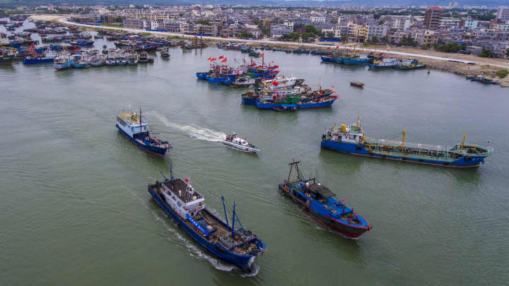 Fishing boats set sail to catch fish in the South China Sea on August 16, 2017 in Sanya, Hainan, China.