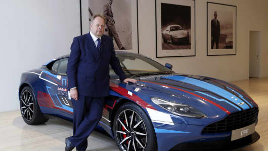 Andy Palmer, CEO of Aston Martin, poses for a photograph with a DB11 sports cars in Singapore, on Saturday, Sept. 16, 2017.
