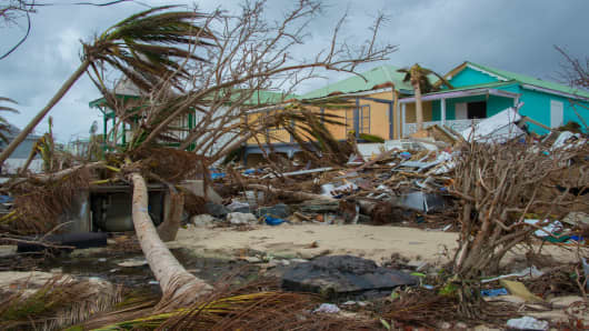 Destroyed trees and houses are seen after the passage of hurricane Irma and Maria in Orient Bay, St. Martin, on September 20, 2017.