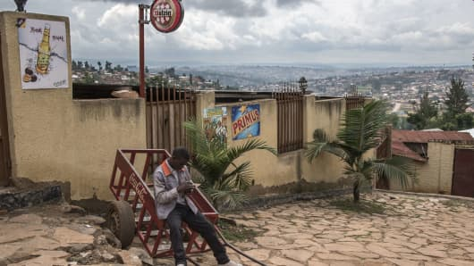 A man consults his mobile phone in the Rwandan capital of Kigali.