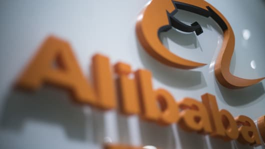 Signage for Alibaba Group is displayed at the company's offices in Hong Kong, China, on Thursday, May 5, 2016.